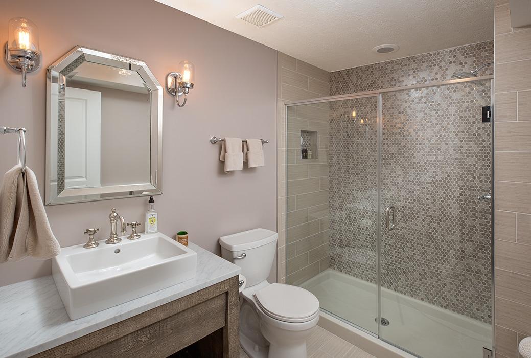 A full bathroom in a basement renovation.