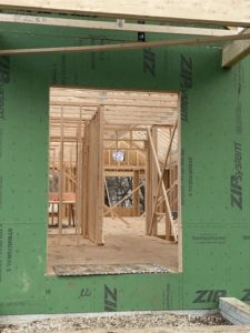 A home being framed while lumber prices are high.