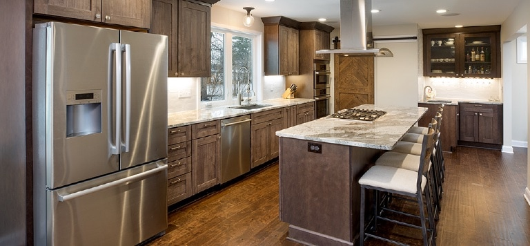An example of stained cabinets in the painted vs. stained cabinetry debate.